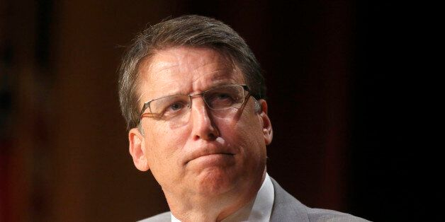 North Carolina Gov. Pat McCrory listens to a question from Tim Boyum during a question and answer session...