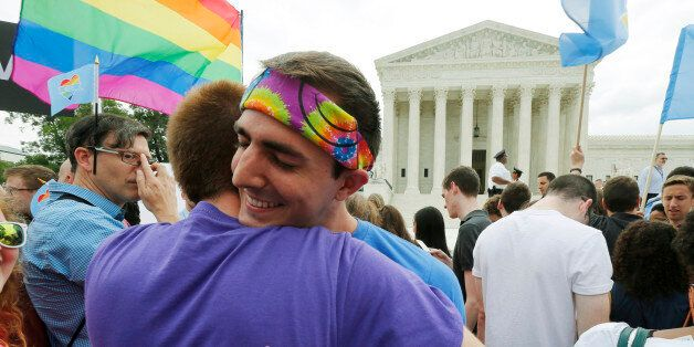 Gay rights supporters celebrate after the U.S. Supreme Court ruled that the U.S. Constitution provides...