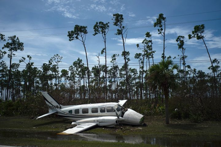 A broken plane lays on the side of a road in the Pine Bay neighborhood in the aftermath of Hurricane Dorian in Freeport, Baha