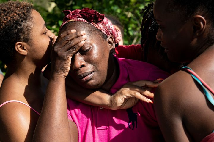 Catherine Russel is greeted by loved ones after arriving with other survivors of Hurricane Dorian from Abaco issland at Odyss