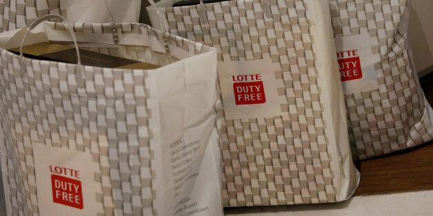 Shopping bags are seen at a Lotte duty free shop in Seoul, South Korea, December 13, 2016. Picture taken...