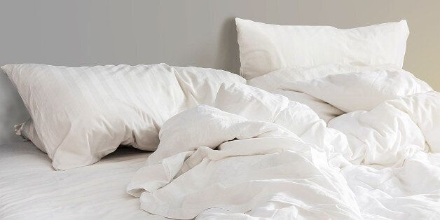 bed and white pillows with wrinkle blanket in bedroom, from sleeping in a long
