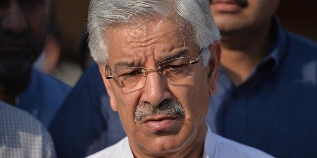 Pakistani Defence Minister Khawaja Asif speaks with media after meeting with patients, who were injured...