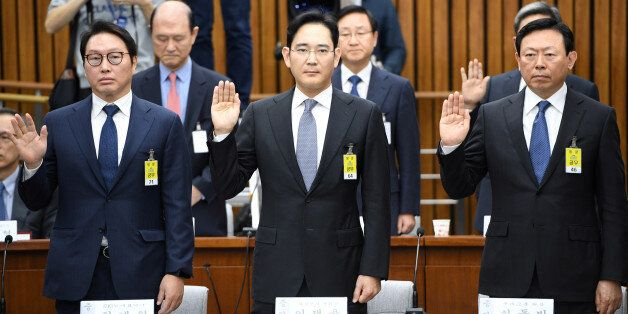 (L-R) SK Group chairman Chey Tae-Won, Samsung Group's heir-apparent Lee Jae-yong and Lotte Group Chairman...
