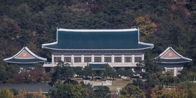 A general view shows the presidential Blue House in Seoul on November 1, 2016.The woman at the centre...