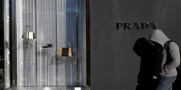 A man walks past a Prada store in Madrid, Spain, March 10, 2016. REUTERS/Susana