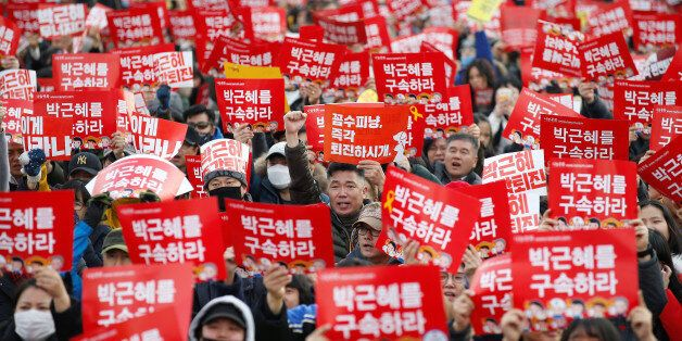 People chant slogans during a protest calling for South Korean President Park Geun-hye to step down in...