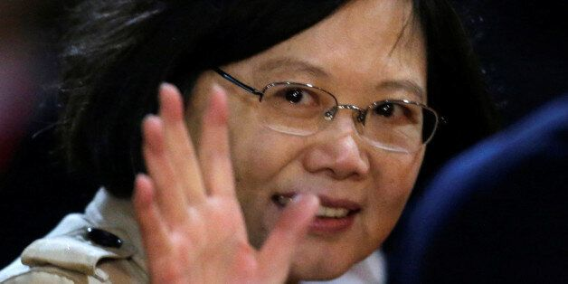 Taiwan's President Tsai Ing-wen gestures after her arrival at the Silvio Pettirossi International airport...