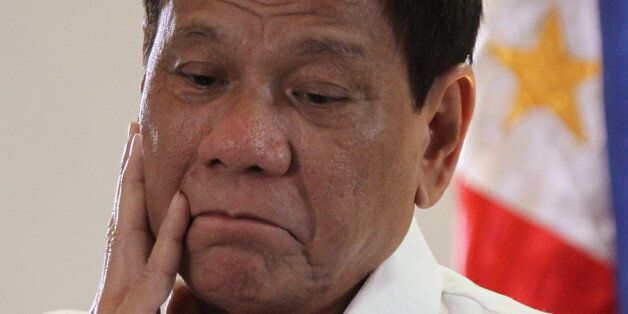 Philippine President Rodrigo Duterte speaks upon his arrival at Davao International Airport in Davao...