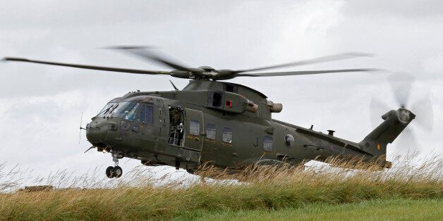 An AW101 Merlin helicopter of the Royal Air Force landing in the field during an exercise in the United