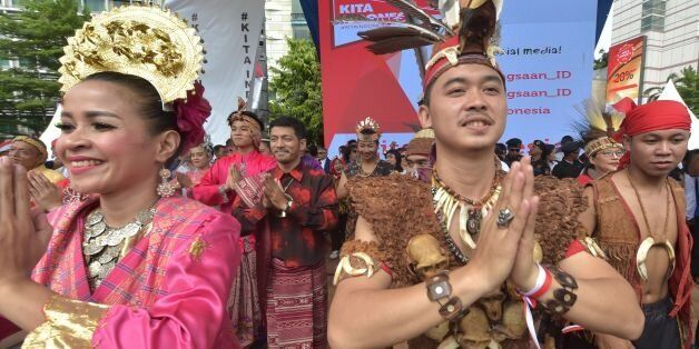 Indonesian dancers perform on a stage during a pro-government rally to call for unity in Jakarta on December...