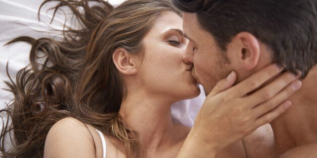 Shot of an affectionate young couple kissing in