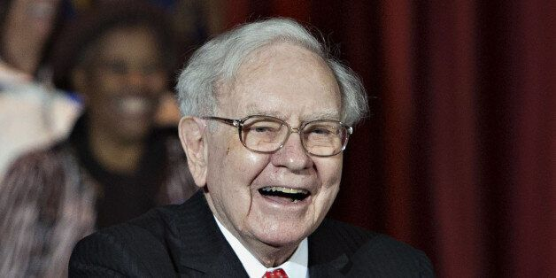 Warren Buffett, chairman and chief executive officer of Berkshire Hathaway Inc., smiles during an event...