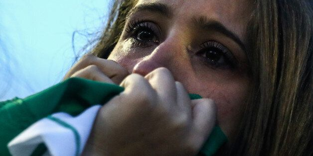 CHAPECO, BRAZIL - NOVEMBER 30: A fan cries while paying tribute to the players of Brazilian team Chapecoense...