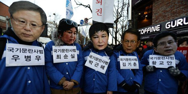 SEOUL, SOUTH KOREA - DECEMBER 10: Protesters wearing masks of South Korea's President Park Geun-Hye (R)...