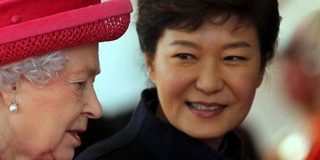 Britain's Queen Elizabeth (L) leads South Korea's President Park Geun-hye during a ceremonial welcome...