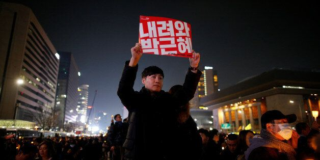A man holds up a sign that