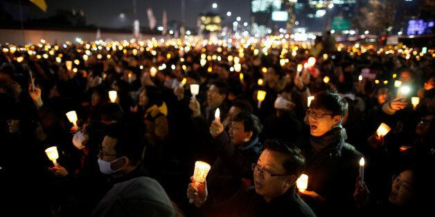 People march toward the Presidential Blue House during a protest calling for South Korean President Park...