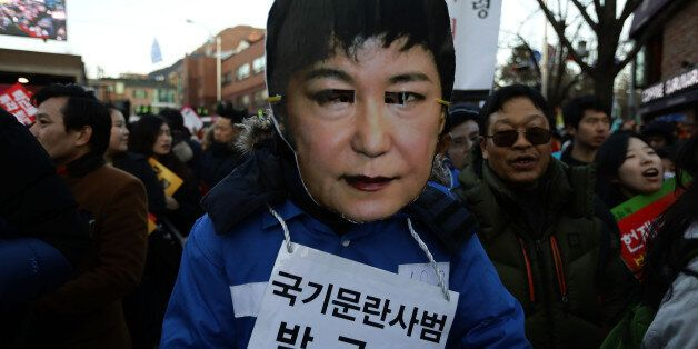 SEOUL, SOUTH KOREA - DECEMBER 10: Protesters wearing masks of South Korea's President Park Geun-Hye during...