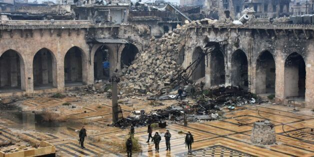 TOPSHOT - A general view shows Syrian pro-government forces walking in the ancient Umayyad mosque in...