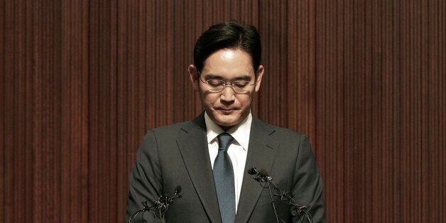 Lee Jae-yong, the heir of the Samsung business empire, reacts during a press conference at the company's...