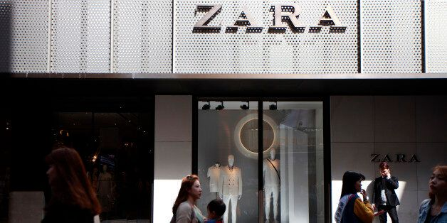 Pedestrians and shoppers walk past a Zara fashion store, operated by Inditex SA, in the Myeongdong shopping...
