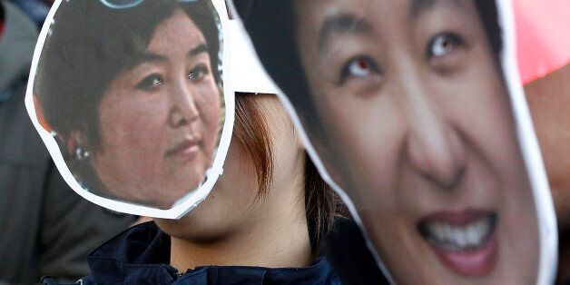 South Korean protesters wearing masks of South Korean President Park Geun-hye, right, and Choi Soon-sil,...