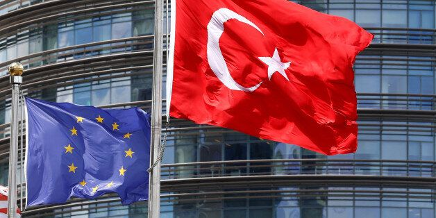 European Union (L) and Turkish flags fly outside a hotel in Istanbul, Turkey May 4, 2016. REUTERS/Murad...
