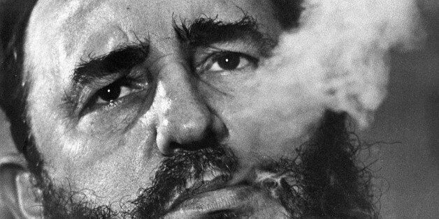 FILE - In this March 1985 file photo, Cuban Prime Minister Fidel Castro exhales cigar smoke during an...
