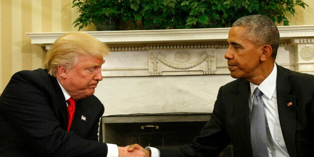 U.S. President Barack Obama shakes hands with President-elect Donald Trump (L) to discuss transition...