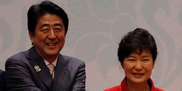 (L to R) Japan's Prime Minister Shinzo Abe, South Korea's President Park Geun-Hye, Myanmar's President...