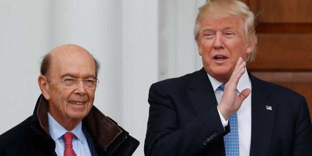 President-elect Donald Trump calls out to media as he greets investor Wilbur Ross at the Trump National...