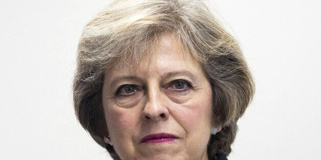 British Prime Minister Theresa May, reacts during a visit to Diabetes UK, where she opened their new...