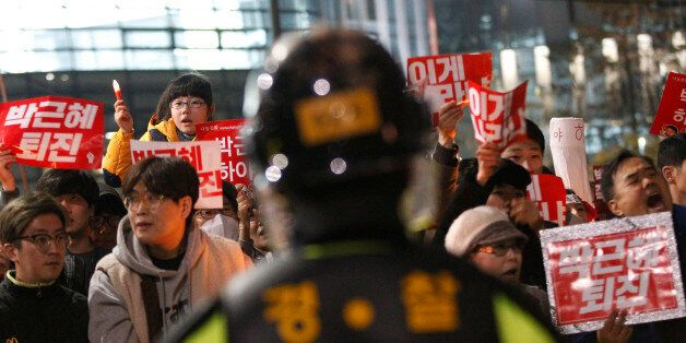 South Korean protesters march toward the presidential house during a rally calling for South Korean President...