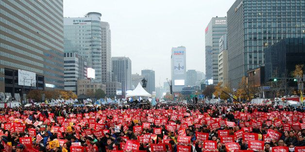 People chant slogans during a protest calling South Korean President Park Geun-hye to step down in Seoul,...