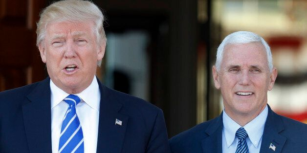 President-elect Donald Trump and Vice President-elect Mike Pence pause for photographs as they arrive...