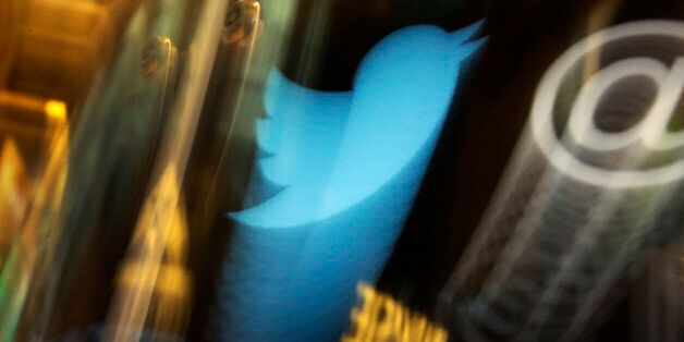 FILE - In this Wednesday, Nov. 6, 2013, file photo, the Twitter logo appears on an updated phone post...