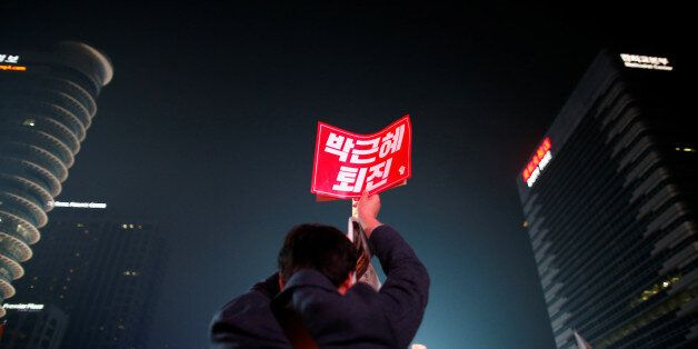 A man holds up a placard that