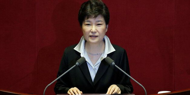 South Korean President Park Geun-hye delivers her speech on the 2017 budget bill during a plenary session...