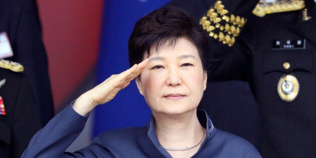 South Korean President Park Geun-hye salutes during the 68th anniversary of Armed Forces Day at the Gyeryong...