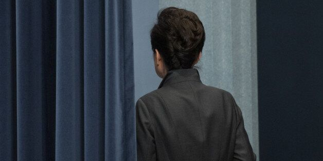 South Korean President Park Geun-Hye exits after delivering an address to the nation, at the presidential...