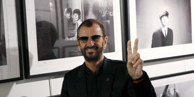 Musician Ringo Starr poses in front of some of his photographs during a media event as he launches his