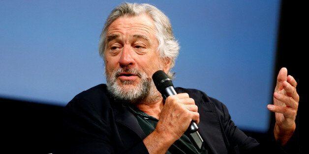 Actor Robert De Niro talks to reporters and film professionals