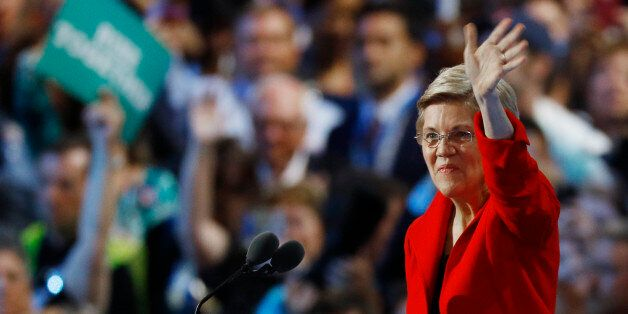 U.S. Senator Elizabeth Warren (D-MA) waves from the podium at the Democratic National Convention in Philadelphia,...