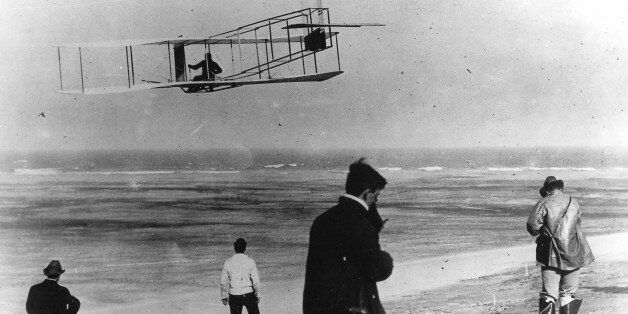 In this undated file photo, Orville and Wilbur Wright test their airplane on a beach. The Wright brothers...