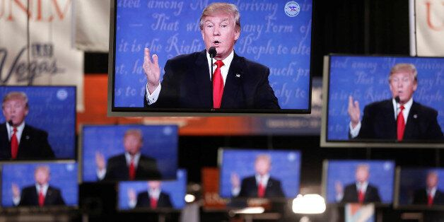 Republican U.S presidential nominee Donald Trump is shown on TV monitors in the media filing room on...