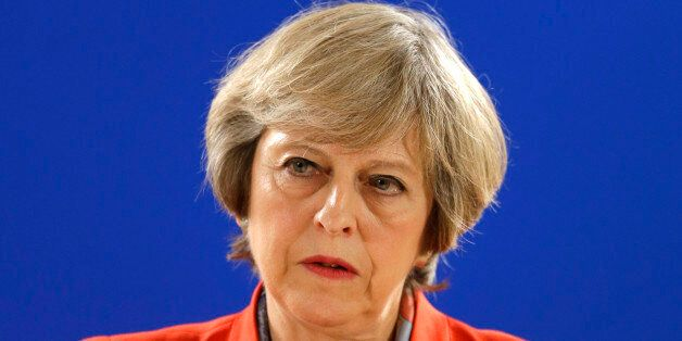 British Prime Minister Theresa May answers a question from the media during the final press briefing...
