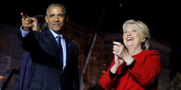 U.S. Democratic presidential nominee Hillary Clinton is joined by U.S. President Barack Obama at a campaign...