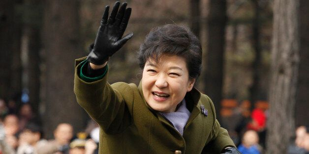 South Korea's new President Park Geun-hye leaves after her inauguration at parliament in Seoul, South...