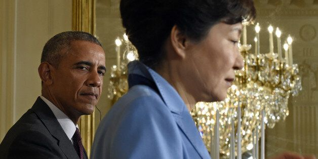 President Barack Obama listens as South Korean President Park Geun-hye speaks during their joint news...
